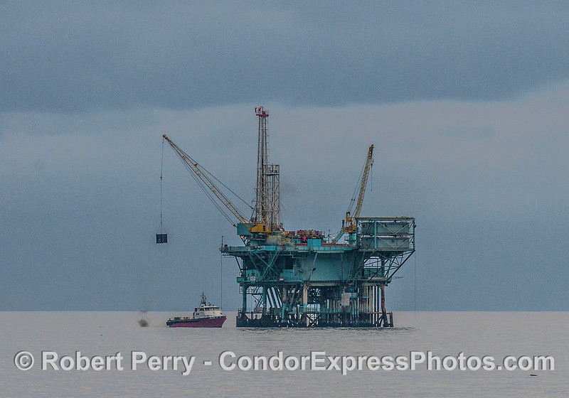 "Vessel ""Alan T"" loading cargo at offshore oil platform ""A"" as dark rain clouds move in to the Channel"