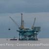 """Vessel """"Alan T"""" loading cargo at offshore oil platform """"A"""" as dark rain clouds move in to the Channel"""