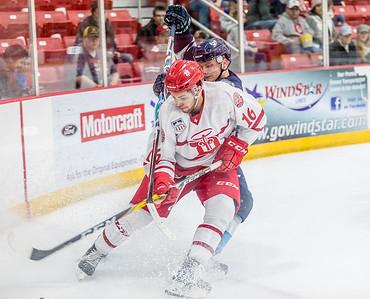 DA029,DJ, Hockey Players go at it near the net