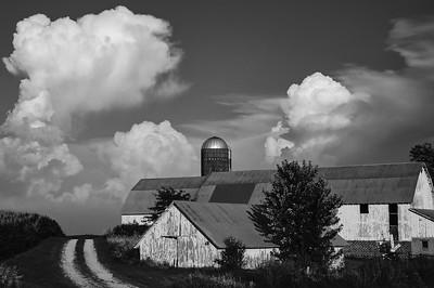 DA099,DB,Thunderheads over farm