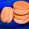 Orange Macarons on Blue Plate