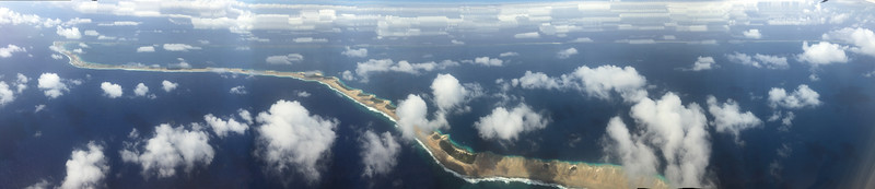 This panoramic shot was taken on iPhone 6 without moving the phone (relative to the plane window, that is) over the course of about 2 minutes.  It shows a large portion of Majuro in a single frame.