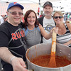 From left, Neil Godbout, Meaghan Pfliger, Frank Peebles, and Colleen Sparrow pose in front of the giant pot of chili on Saturday as The Prince George Citizen team was only one of twelve teams competing at the Community Arts Council's Spring Arts Bazaar and the Prince George Potters Guild's 41st Annual Great Northern Chili Cookoff at Studio 2880. Citizen Photo by James Doyle     June 4, 2016