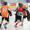 BX Pub Bandits Drew Doig runs the ball past the check of Westwood Pub Devils Monty Jones (left) and Asahel Beaudet (right) on Thursday at Kin 1. The Bandits and the Devils met in the first game of the best-of-five Prince George Senior Lacrosse Association finals. Citizen Photo by James Doyle      July 14, 2016