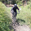 A mountain biker makes their way down the trail Beaver Berms, at Tabor Mountain on Saturday for the opening day of the bike park. Citizen Photo by James Doyle      July 16, 2016