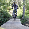 A mountain biker makes their way across a wooden bridge on the trail Loosey Goosey, at Tabor Mountain on Saturday for the opening day of the bike park. Citizen Photo by James Doyle      July 16, 2016