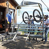 Mountain bikers wait as their bikes get unloaded off the chairlift at Tabor Mountain on Saturday for the opening day of the bike park. Citizen Photo by James Doyle      July 16, 2016