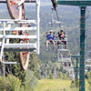 Mountain bikers and their bikes make their way up the chairlift at Tabor Mountain on Saturday on opening day of the bike park. Citizen Photo by James Doyle      July 16, 2016