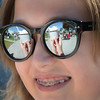 Katrina Strybos, 12, is enjoying an icecreame, reflected in her glasses, on the steps of City Hall Friday afternoon during Foodie Fridays. The food truck event on the front lawn of City Hall every Friday. Citizen photo by Brent Braaten    Aug 12 2016