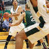 UNBC Timberwolves Sam Zhang eyes up his next move on Saturday at Northern Sport Centre during the UNBC alumni basketball game. Citizen Photo by James Doyle     September 24, 2016