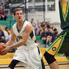 UNBC Timberwolves Rhys Elliot looks for an open teammate on Saturday at Northern Sport Centre during the UNBC alumni basketball game. Citizen Photo by James Doyle     September 24, 2016