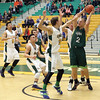 UNBC alumni player Colin Plumb is surrounded by the UNBC Timberwolves as he looks for an open teammate on Saturday at Northern Sport Centre during the UNBC alumni basketball game. Citizen Photo by James Doyle     September 24, 2016
