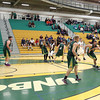 UNBC Timberwolves Vaggelis Loukas drives past UNBC alumni player Dennis Stark (green) on Saturday at Northern Sport Centre during the UNBC alumni basketball game. Citizen Photo by James Doyle     September 24, 2016