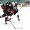 Prince George Cougars forward Yan Khomenko skates the puck around Vancouver Giants defenceman Bailey Dhaliwal on Friday at CN Centre. The Cougars and Giants met in the first game of a weekend doubleheader with the Cougars looking to add another victory to their undefeated streak. Citizen Photo by James Doyle      October 7, 2016