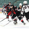 Prince George Cougars forward Kody McDonald looks to skate the puck around the check of Vancouver Giants defenceman Tyler Brown on Friday at CN Centre. The Cougars and Giants met in the first game of a weekend doubleheader with the Cougars looking to add another victory to their undefeated streak. Citizen Photo by James Doyle      October 7, 2016