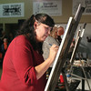 Carla Joseph Aubichon puts paint to canvas in the second round during Art Battle on Friday at Hubspace. Citizen Photo by James Doyle      Ocotober 7, 2016