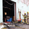 Crews knock down hot spots and begin mop-up after a structure fire on Friday morning at 4402 Giscome Road. Four fire halls responded to find the out building ablaze around 4:30 a.m. Friday morning. Citizen Photo by James Doyle     October 7, 2016