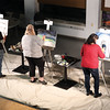 From left, Michael Rees, Lisa Marie Tosoff, and Carla Joseph Aubichon take part in the second round during Art Battle on Friday at Hubspace. Citizen Photo by James Doyle      Ocotober 7, 2016