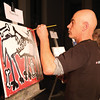 Michael Rees puts paint to canvas in the second round during Art Battle on Friday at Hubspace. Citizen Photo by James Doyle      Ocotober 7, 2016