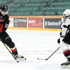 Prince George Cougars forward Yan Khomenko toe-drags the puck around the outstretched stick of Vancouver Giants defenceman Bailey Dhaliwal on Friday at CN Centre. The Cougars and Giants met in the first game of a weekend doubleheader with the Cougars looking to add another victory to their undefeated streak. Citizen Photo by James Doyle      October 7, 2016