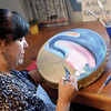 Carla Joseph Aubichon Community Arts Council artist in residence paints a drum Wednesday morning. Community Arts Council launched an Invest Local BC Campaign to help raise funds for repairs to the building. citizen photo by Brent Braaten   Oct 26 2016