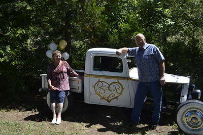 Allen painted an old truck in their yard with Golden Wedding Anniversary colors and designs for the BBQ.