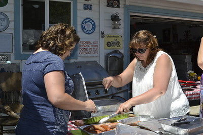 Michelle and her friend getting the food ready