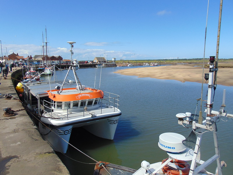 Boats in Wells-Next-The-Sea harbour and quay.