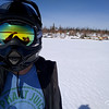 Snowmobiling around the lake