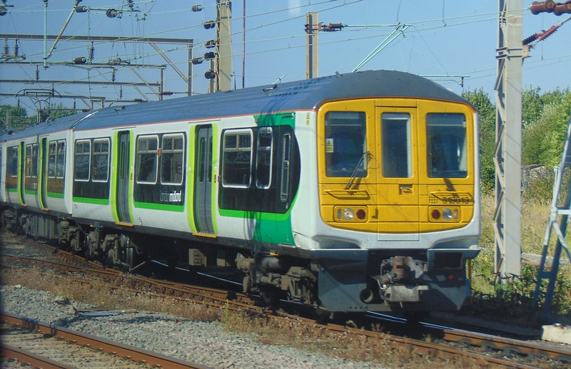 Newly reliveried London Midland Class 319 no. 319013 at Bletchley.