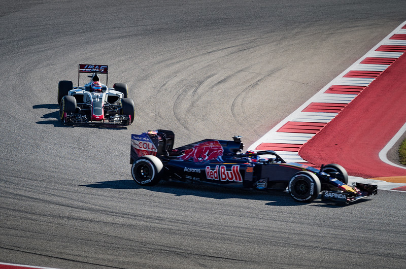 Scuderia Toro Rosso's Daniil Kvyat tests the Ferrari-designed Halo cockpit protection system as Haas F1 Team driver Romain Grosjean follows in quick pursuit during Free Practice 1. Friday, October 21, 2016. United States Grand Prix. Circuit of the Americas, Turn 15. Austin, Texas.