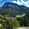 "One of my absolute favorite views, and the home to one of my favorite photos, was taken here, along the Hoodoo Trail just outside the town of Banff. I took Sammi straight here. You can see some of the ""hoodoo""'s in the middle left of the photo -- those white rocky looking stick thingy things."