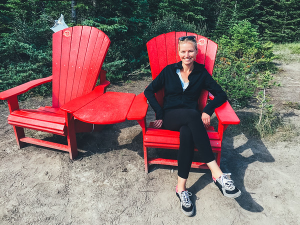 Sammi loves all things red, so when she found these red chairs with a stunning view, of course she was a happy camper!
