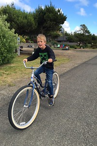 Riding the adult-size beach cruiser!