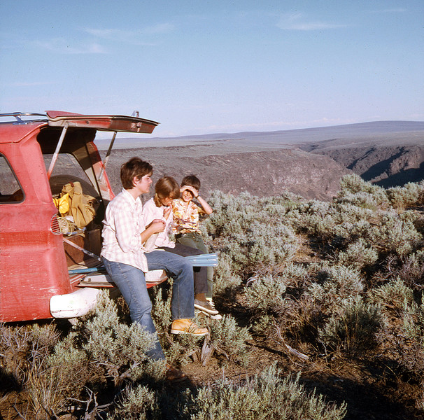 0329 Cheri Lorie Lyle sit on Old Red eating at the rim of Bruneau River Canyon summer 1969