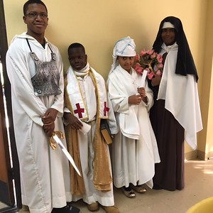 """Saints"" before their presentationsPayton Gibson (9th) as St. Michael the Archangel, Caleb Onyemara (4eth grade) as St. Basil, Mia Mornay (3rd grade) as St. Mdacrina, Myla            Thomas (10th grade) as St. Therese of Lisieux        10:30 AM Mass"