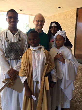 "Msgr. Gauthreaux with our ""saints"" after Mass"