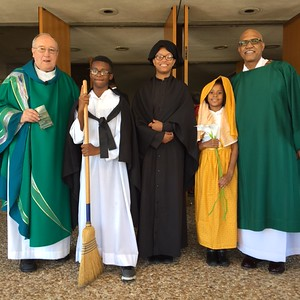 Fr.Bracken, SVD and Deacon Broussard with Kaden Shaw (7th grade) as St. Martin dePorres, Maxine Mitchell (9th grade) as St. Josephine            Bakhita, Brevyn Malvveaux (2nd grade) as St. Maria Goretti          12:00 PM