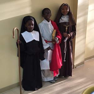 Malaya Sanders (5th grade) as St. Mella, Michael Sanders (6th grade) as St. John the Evangelist,  Amaiya Thompson (8th grade) as St. Rita       8:30 AM Mass