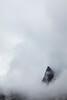Pinnacle Peak juts through the higher clouds over Archangel Valley.