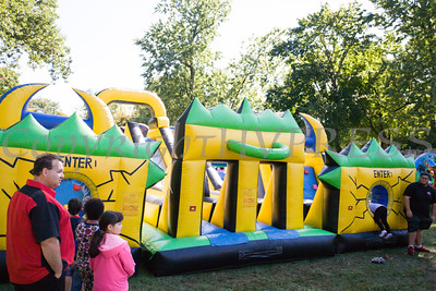 Children enjoy the inflatables at Affinity Health Plans Third Annual Family Fall Festival in Downing Park on Saturday, September 24, 2016 in Newburgh, NY. Hudson Valley Press/CHUCK STEWART, JR.