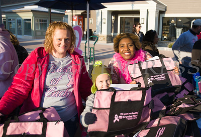 Heather Dembek, Brandon, and Najee McKinney hand out bags from Crystal Run as thousands of people, including cancer survivors, their families and businesses, participated in the annual American Cancer Society Making Strides Against Breast Cancer walk at Woodbury Common Premium Outlets in Central Valley, NY on Sunday, October 16, 2016. Hudson Valley Press/CHUCK STEWART, JR.