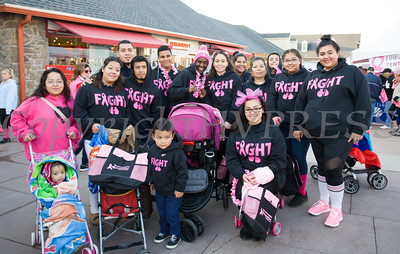 "Group ""Fight"" (walking for Maribel and Maria, both survivors of breast cancer) joined thousands of people, including cancer survivors, their families and businesses, in the annual American Cancer Society Making Strides Against Breast Cancer walk at Woodbury Common Premium Outlets in Central Valley, NY on Sunday, October 16, 2016. Hudson Valley Press/CHUCK STEWART, JR."