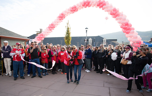 "Breast Cancer survivors Debie Roth and Suzy Merin of group ""Thing 1, Thing 2"" cut the ribbon as thousands of people, including cancer survivors, their families and businesses, participated in the annual American Cancer Society Making Strides Against Breast Cancer walk at Woodbury Common Premium Outlets in Central Valley, NY on Sunday, October 16, 2016. Hudson Valley Press/CHUCK STEWART, JR."