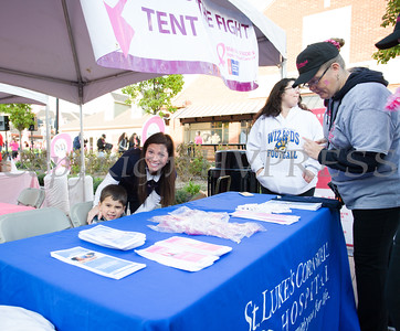 Kate Dabroski and Jack at the St. Luke's Cornwall Hospital table helping as thousands of people, including cancer survivors, their families and businesses, participated in the annual American Cancer Society Making Strides Against Breast Cancer walk at Woodbury Common Premium Outlets in Central Valley, NY on Sunday, October 16, 2016. Hudson Valley Press/CHUCK STEWART, JR.