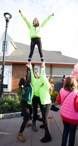 Cornwall High School Varsity Cheerleaders cheer on thousands of people, including cancer survivors, their families and businesses, who participated in the annual American Cancer Society Making Strides Against Breast Cancer walk at Woodbury Common Premium Outlets in Central Valley, NY on Sunday, October 16, 2016. Hudson Valley Press/CHUCK STEWART, JR.