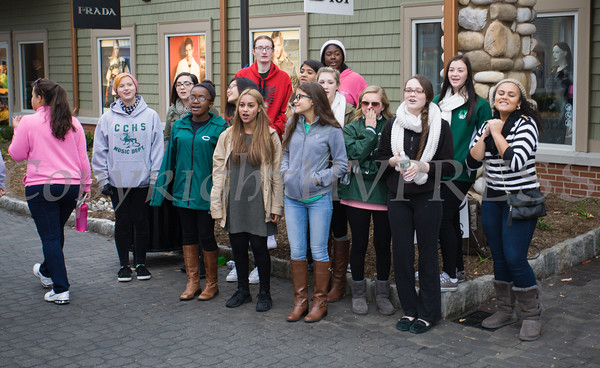 """The Cornwall High School acapella group """"Love Notes"""" performs as thousands of people, including cancer survivors, their families and businesses, participated in the annual American Cancer Society Making Strides Against Breast Cancer walk at Woodbury Common Premium Outlets in Central Valley, NY on Sunday, October 16, 2016. Hudson Valley Press/CHUCK STEWART, JR."""
