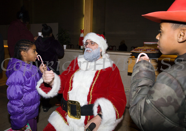 Santa Claus hands out gifts and candy canes in the Karpeles Manuscript Museum as the City of Newburgh welcomed its Broadway tree during its official dedication and tree lighting ceremony on Wednesday, December 14, 2016. Hudson Valley Press/CHUCK STEWART, JR.