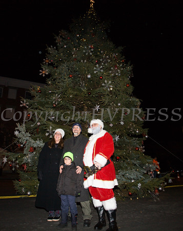Newburgh City Manager Michael Ciaravino and his family pose with Santa Claus as the City of Newburgh welcomed its Broadway tree during its official dedication and tree lighting ceremony on Wednesday, December 14, 2016. Hudson Valley Press/CHUCK STEWART, JR.