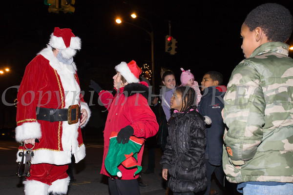 Santa Claus is greeted by Deputy Mayor Regina Angelo as the City of Newburgh welcomed its Broadway tree during its official dedication and tree lighting ceremony on Wednesday, December 14, 2016. Hudson Valley Press/CHUCK STEWART, JR.
